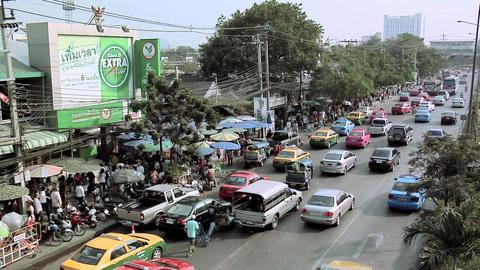 Afternoon Traffic besides the Chatuchak Market on Kamphaeng Phet, Bangkok Live Action
