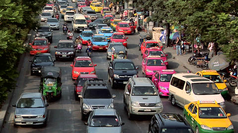 Afternoon Traffic besides the Chatuchak Market on Kamphaeng Phet, Bangkok Live Action