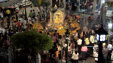 Evening Worshippers at Erawan Shrine, Bangkok Live Action