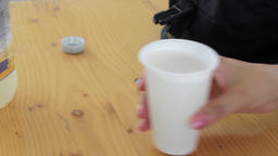 Man who pours of a woman juice in a plastic cup 1 Footage