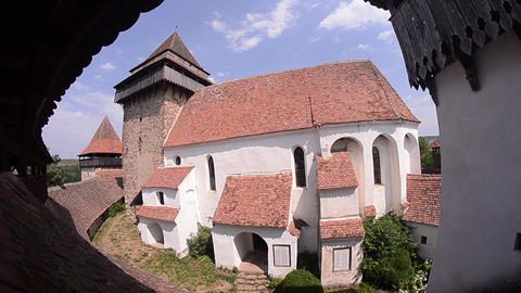 Old church surrounded by high walls which is seen in a guard tower 2a Footage