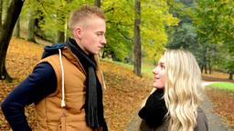 happy couple talk (conversation) - autumn park (nature) - couple smiles (happy) Footage