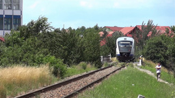 Passenger train departs from station 13 Footage