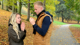 happy couple in autumn park (nature) - man and woman shiver with cold - couple t Footage