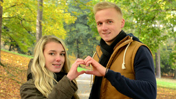 young model couple in love - autumn park(nature) - happy couple - couple forms a Footage