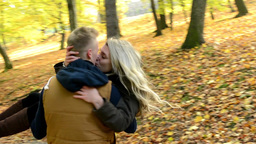 young model couple in love - autumn park(nature) - couple holding hands - woman  Footage