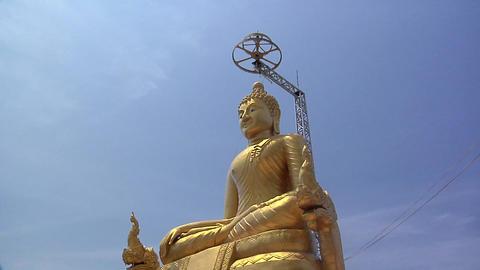 Golden Buddha besides the Big Buddha Statue at Wat Phrathong Footage