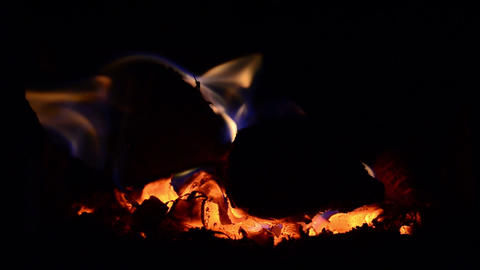 Playful flames that engulfed a wood put in the stove to warm the cold air in the Footage