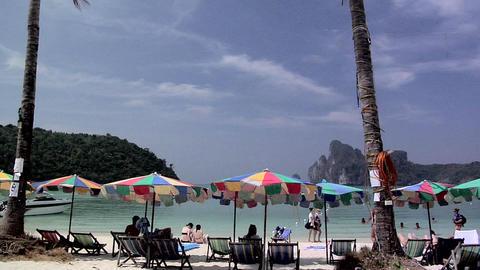 Tourists And Beach Chairs On Ao Ton Sai Beach stock footage