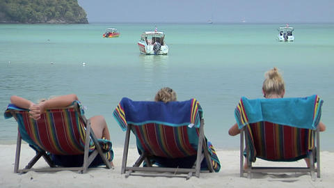 3 Scandinavian Girls enjoy the sun in Beach Chairs on Ao Ton Sai Beach Footage