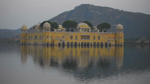 Jal mahal palace on lake at night in Jaipur India Footage