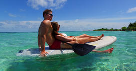 v11305 two 2 people romantic young people couple paddleboard surfboard with Footage