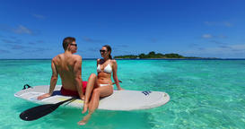 v11369 two 2 people romantic young people couple paddleboard surfboard with Live Action