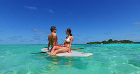 v11364 two 2 people romantic young people couple paddleboard surfboard with Live Action