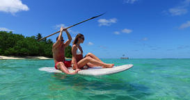 v11330 two 2 people romantic young people couple paddleboard surfboard with Footage