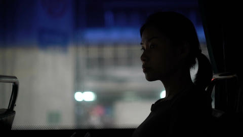 Young Asian Woman sitting in bus during evening ビデオ