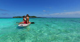 v11370 two 2 people romantic young people couple paddleboard surfboard with Footage