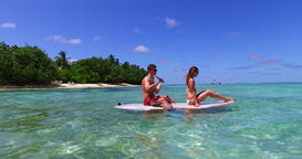 v11312 two 2 people romantic young people couple paddleboard surfboard with Footage