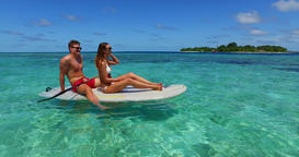 v11302 two 2 people romantic young people couple paddleboard surfboard with Footage