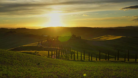 Tuscany landscape road cypresses hill sunset Footage