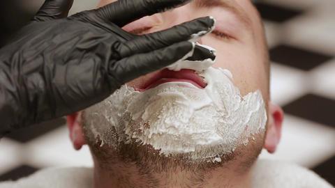 close-up face of a man spread shaving foam. Barber, barbershop Footage