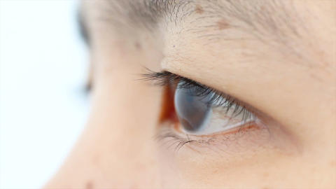 4K Close up shot eye of woman open and close shallow depth of field 002 Footage