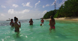 v12673 group of young beautiful girls playing beach ball and sunbathing in aqua Footage