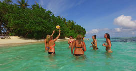 v12675 group of young beautiful girls playing beach ball and sunbathing in aqua Live Action