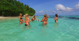 v12686 group of young beautiful girls playing beach ball and sunbathing in aqua Live Action