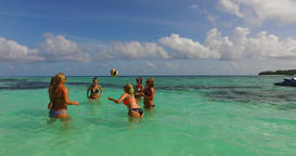 v12690 group of young beautiful girls playing beach ball and sunbathing in aqua Live Action
