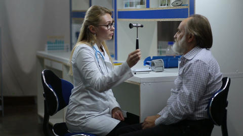 Woman doctor inspecting patient's nervous system Live Action