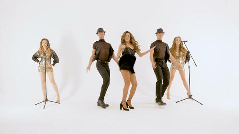 Five professional actors dance energetically in the studio. White background Footage