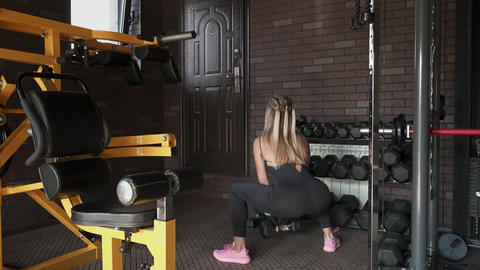 woman doing squat with dumbbell Footage