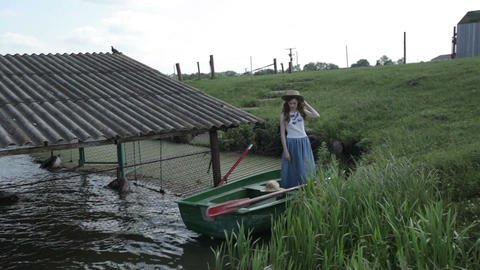 The girl in the boat GIF
