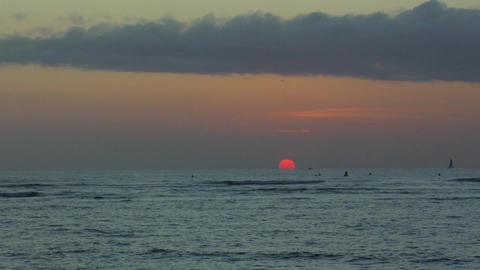 Setting Sun on Waikiki Beach, Honolulu, Hawaii Live Action
