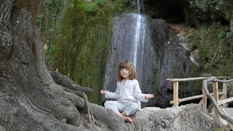 little girl meditates in nature Footage