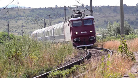 Train approaches a station after a long journey through the hills 18 Footage