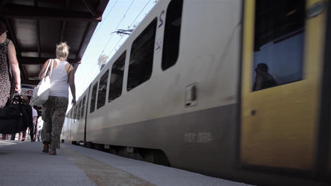 Train leaving the station and passengers get out on the platform 23 Footage