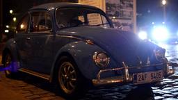 night vintage car - night urban street with cars - car headlights Footage