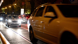 night city - night urban street with cars and trams - lamps - car headlight Footage