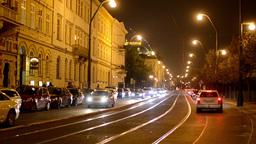 night city - night urban street with cars and trams - lamps(lights) - car headli Footage