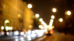 night city - night street with cars - lamps - car headlight - building - blurred Footage