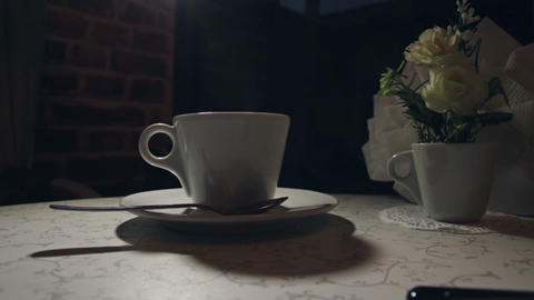 Man stirring coffee, close-up, shallow DOF Footage