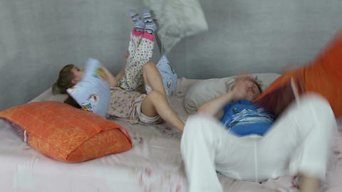 Kids rage on inflatable bed Footage