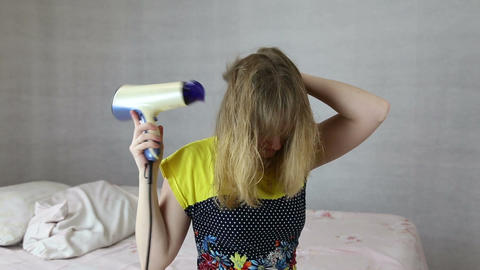 The girl dries hair hairdryer Footage