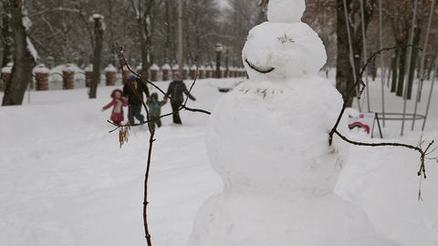 Snowman in the park in winter Footage