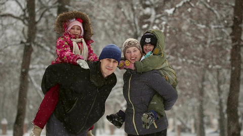 Happy family during a snowfall Footage