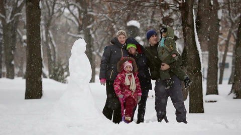 Happy family with many children, who sculpted snowman Footage