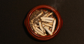 Time Lapse Shot Of A Cigarette Burning To Ash In The Ashtray stock footage