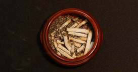 A cigarette burning to ash in the ashtray Footage